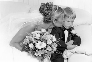 Photographed at the brides house, bride kissing ringbearer candid